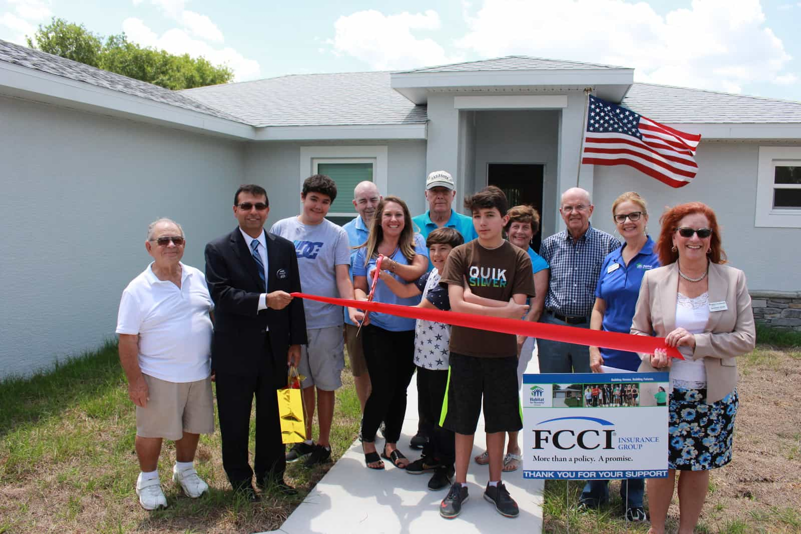 Members from FCCI with a Habitat Sarasota homeowner at her home dedication.